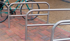 Double steel ground fixed bicycle secure stands.