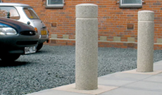 A cast iron dockyard vehicle access bollard.