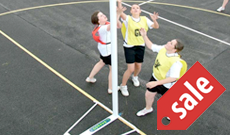 Schools wheeled steel netball post goals.