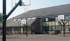 Outdoor playground basketball multi play area installation.
