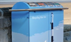 Branded outdoor public litter bins.