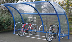 Enclosed single canopy bicycle storage shelter.