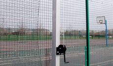 Steel tennis court dividing net posts.