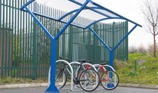 Outdoor single canopy bicycle storage shelter.