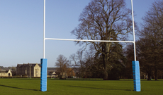 Steel hinged folding rugby posts.