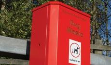 Freestanding council steel dog waste bin.