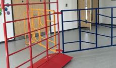Folding steel wall mounted school PE gymnasium frames.