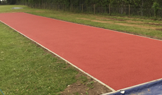 Ipswich school outdoor polymeric multiple athletic run and landing area pit.