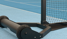 Integral weighted mobile tennis posts with roller base.