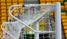 Stadium 3G steel tubular net elbow supports.