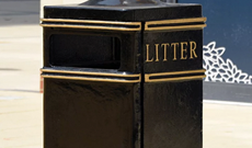 Cast iron large square ground fixed public litter bin.