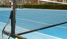 Steel wheeled mobile tennis posts with winder.