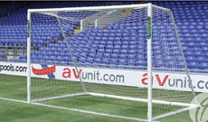 Polygoal PVC plastic freestanding football goalposts.