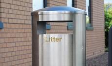 Public dunbar stainless steel litter bin.