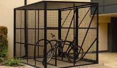 Secure single steel mesh bicycle storage shelter.