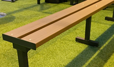 Steel and timber freestanding players sideline bench.