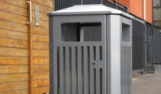 Public gate grid stainless steel litter bin.