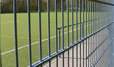Custom and standard tennis court fencing.
