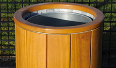 Natural timber open ground fixed use litter bin.