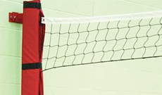 Wall mounted steel volleyball posts.