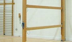 Timber wall mounted folding climbing gymnasium balance beams.