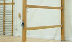 Timber wall mounted folding climbing gymnasium balance beams.