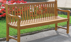 Outdoor public wooden public use seating bench.